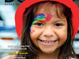 Burien Magazine cover. Child wearing firefighter hat.