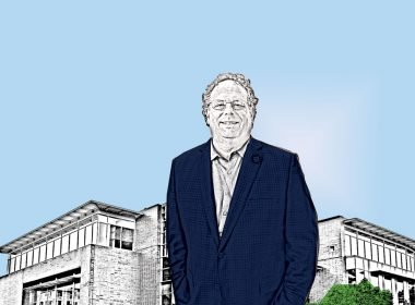 Illustration of City Manager Brian Wilson standing in front of Burien City Hall