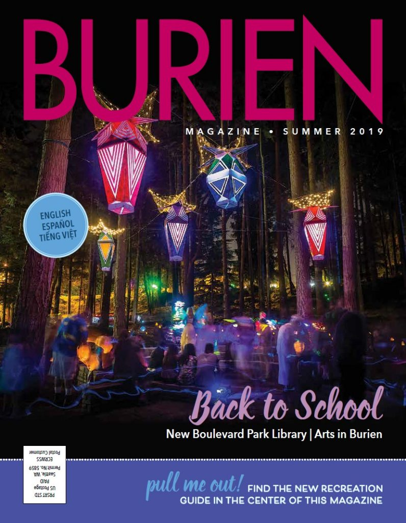 Burien Magazine cover. Arts-A-Glow light art installation in forest.