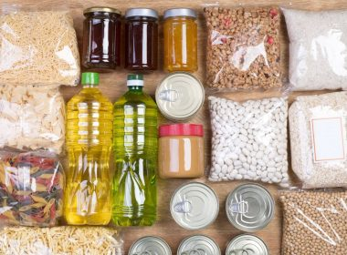 Cans, jars, and bags of food.