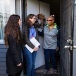 Three people in doorway.