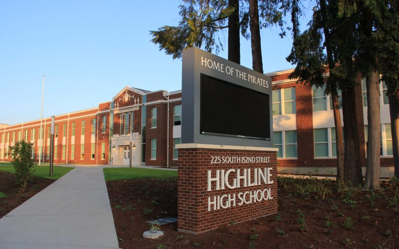 Highline High School sign and front of building.