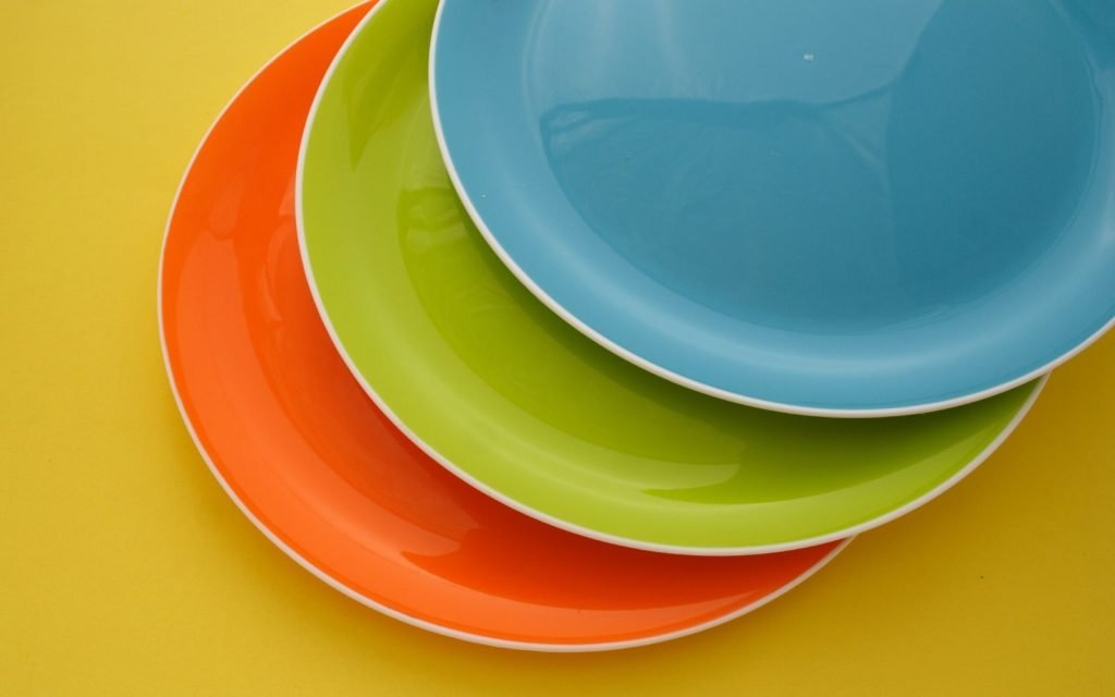 Photograph of three colorful plates.